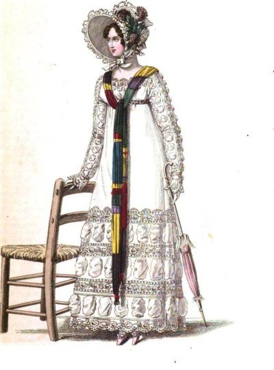From the October 1818 edition, La Belle Assemblee, we have the Parisian promenade dress made of cambric muslin and trimmed in muslin medallion puffs which are separated by rich embroidery, topped by a bonnet of white crape trimmed with blond and purple poppies on the side
