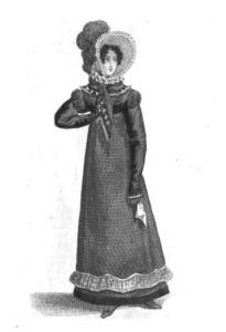 Inevitably, bombazine is the dress material of mourning. This illustration of a carriage dress suitable for mourning, from the Magazine's November issue, is liberally trimmed in black velvet, from spencer to hem.
