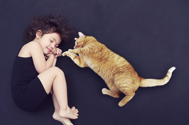 sleeping girl, pouncing cat